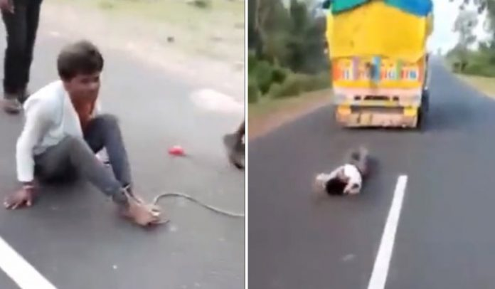 Barbarism displayed as a man is dragged by a truck, ultimately died